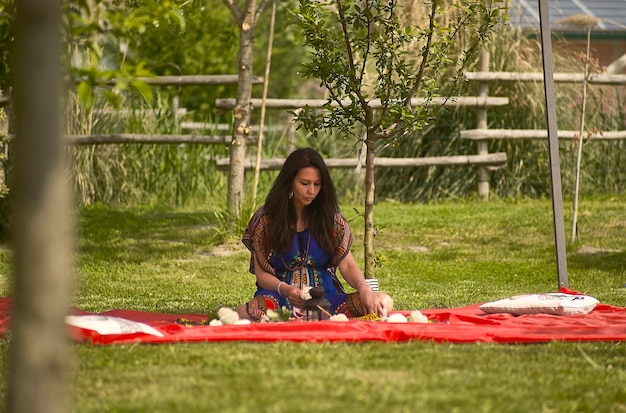 Portrait of a shaman woman in nature in spring