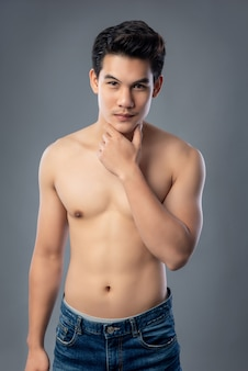 Portrait of shirtless young handsome asian man studio shot