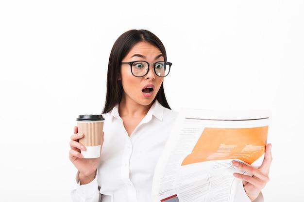 Portrait of a shocked asian businesswoman