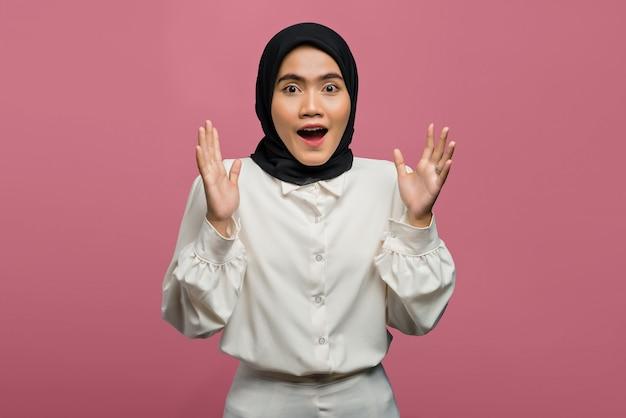 Portrait of shocked beautiful asian woman wearing a white shirt