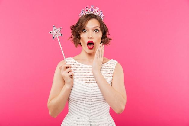 Portrait of a shocked girl wearing crown
