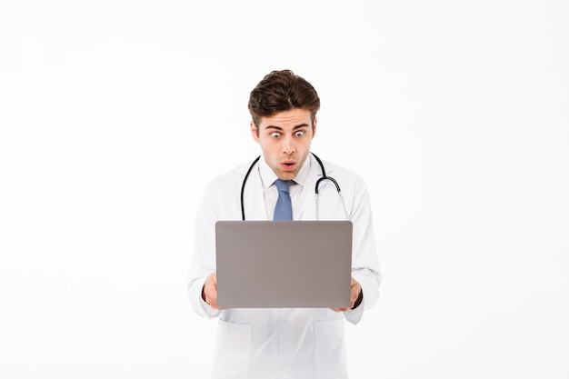 Portrait of a shocked male doctor with stethoscope