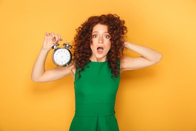 Portrait of a shocked redhead woman in dress