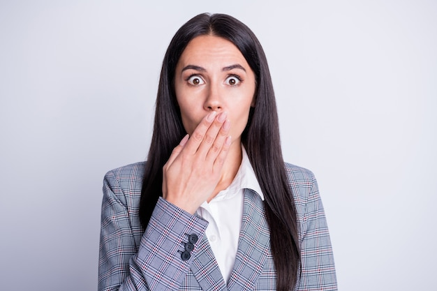 Portrait of shocked representative girl close cover lips hand share private corona virus crisis dismissed secret novelty wear checkered plaid suit jacket isolated gray color background