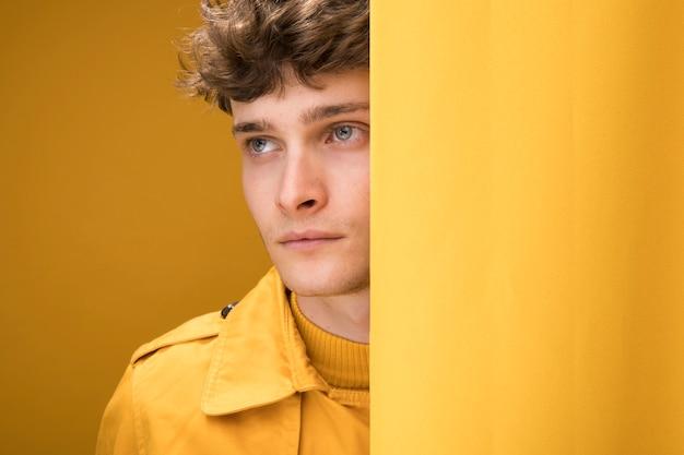Portrait of shy fashionable boy