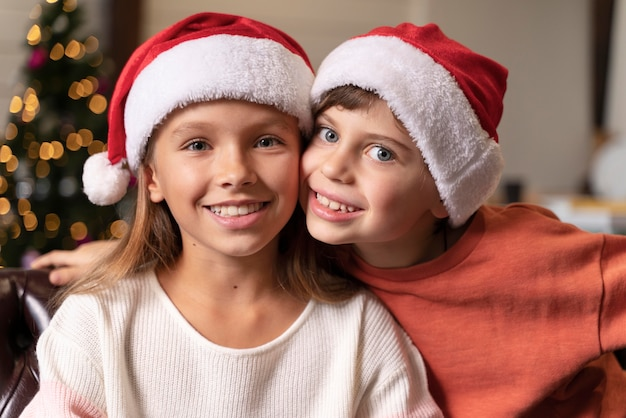 Portrait of siblings celebrating christmas together