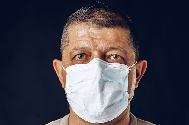 Portrait of a sick adult man in medical mask close up. coronavirus pandemia concept