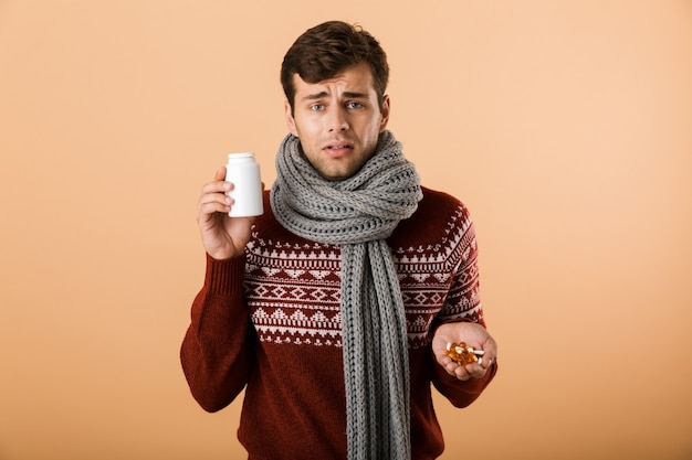 Portrait a sick man dressed in sweater and scarf