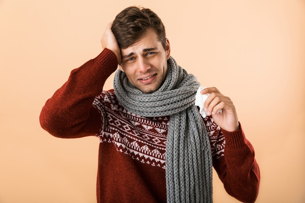 Portrait of a sick young man dressed in sweater