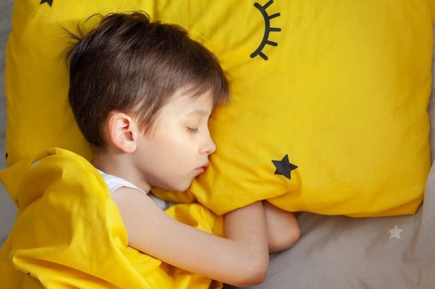 Portrait sleeping child on soft light background.