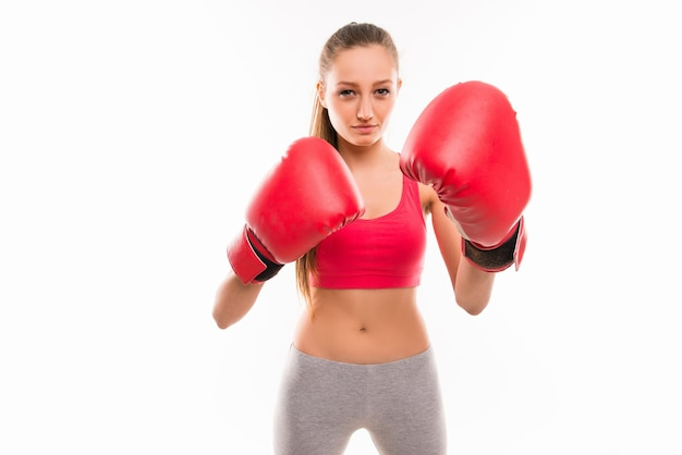 Portrait of slim young sexy girl in boxing gloves