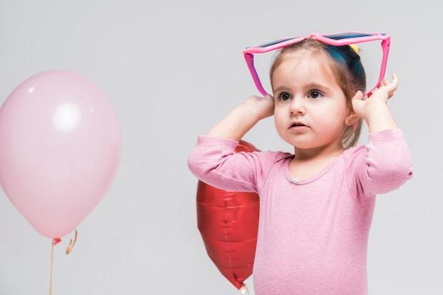 Portrait of small little girl posing
