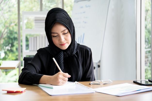 Portrait of smart beautiful asian businesswoman working in the office