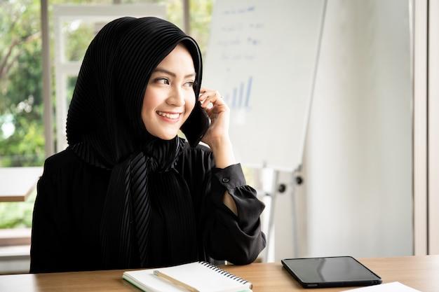 Portrait of smart beautiful muslim businesswoman working in the office