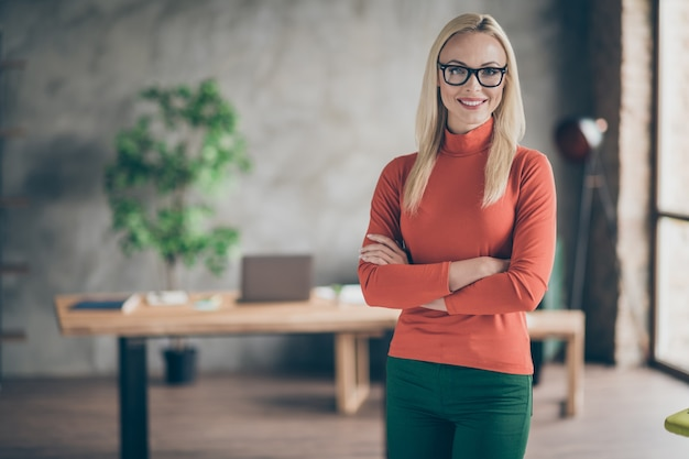 Portrait of smart cool woman big enterprise owner cross her hands ready to work with investors partners in modern office red turtleneck