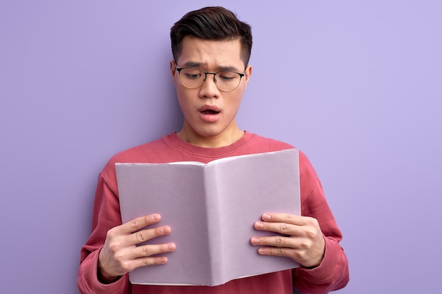 Portrait of smart intelligent chinese student reading book
