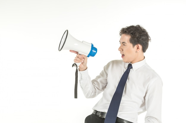 Portrait of smart young asian businessman wearing white shirt shout with wireless speaker megaphone on isolated white background and copy space.
