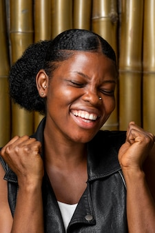 Portrait of smiley african woman being victorious
