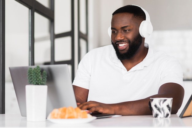 Portrait of smiley man enjoying work from home