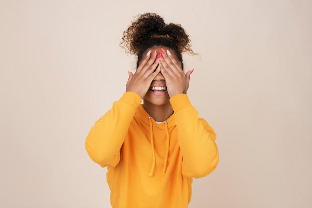 Portrait of smiley teenage girl wearing a sweatshirt