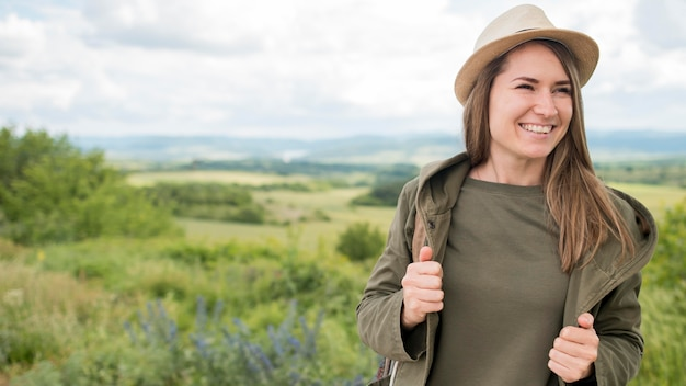 Portrait of smiley traveller posing outdoors