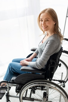 Portrait of smiley woman in wheelchair