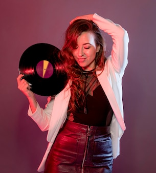 Portrait smiley woman with vinyl