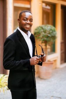 Portrait of a smiling african business man in the city