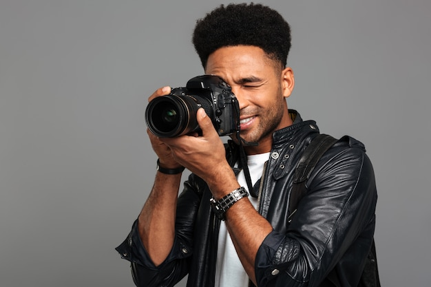 Portrait of a smiling afro american male photographer