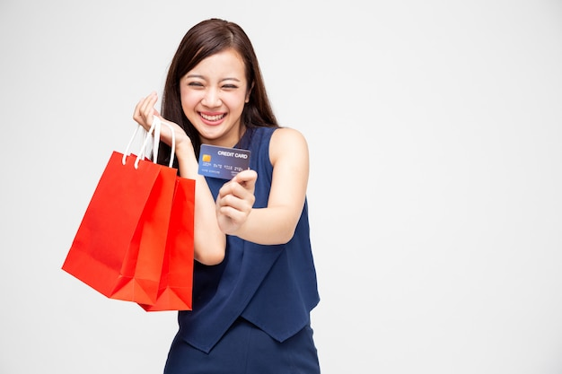 Portrait of smiling asian woman wearing blue dress