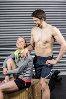 Portrait of smiling athletic couple at crossfit gym