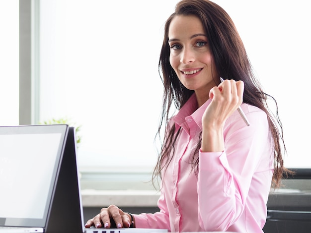 Portrait of smiling beautiful businesswoman looking at camera with happiness.