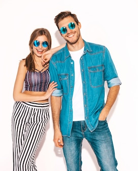 Portrait of smiling beautiful girl and her handsome boyfriend laughing.happy cheerful couple in sunglasses.