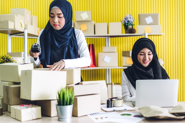 Portrait of smiling beautiful two muslim owner asian woman freelancer