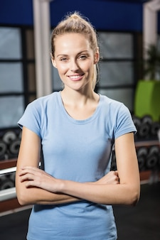 Portrait of smiling blonde with arms crossed at the gym