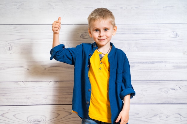 Portrait of a smiling boy with thumb up