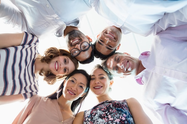 Portrait of smiling business colleagues forming hurdle