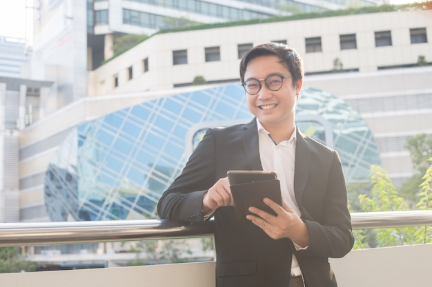 Portrait of smiling business man look confident using computer tablet