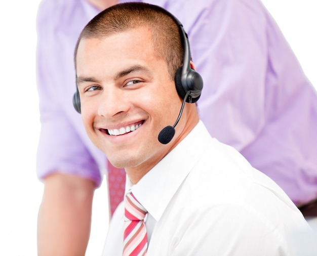 Portrait of a smiling businessman using a headset