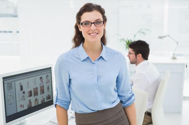 Portrait of smiling businesswoman standing