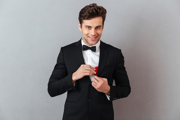 Portrait of a smiling charming man dressed in tuxedo