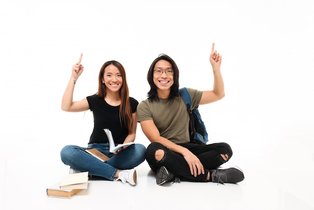 Portrait of a smiling cheerful asian students couple