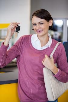 Portrait of smiling customer holding keys
