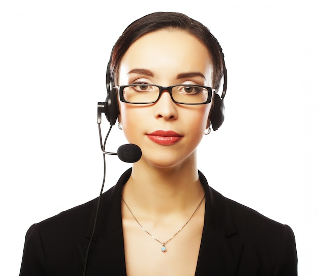 Portrait of smiling customer support female phone worker, over w