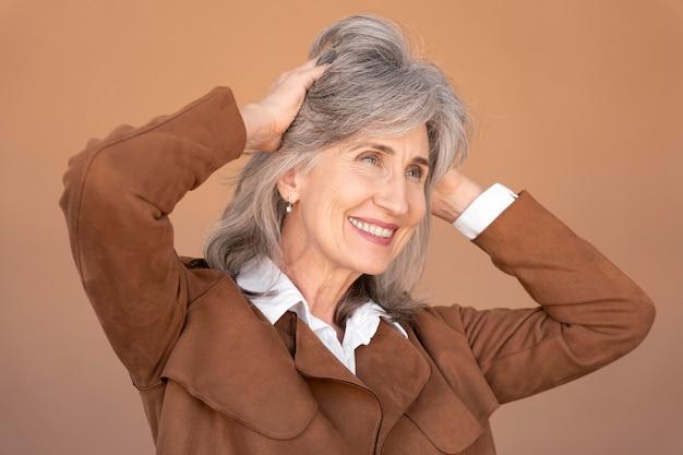 Portrait of smiling elegant senior woman