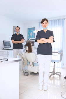 Portrait of smiling female and male dentist in clinic