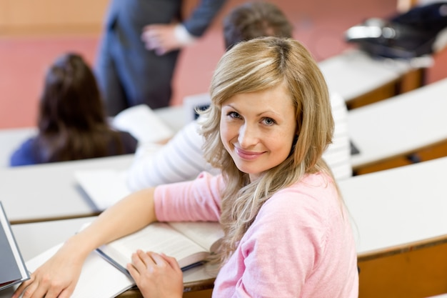 Portrait of a smiling female student during a university lesson