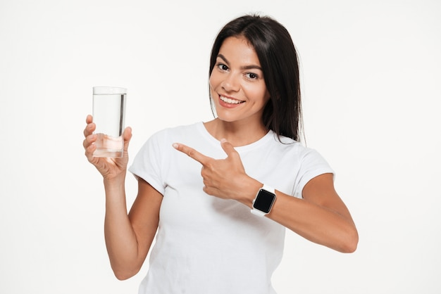 Portrait of a smiling fit woman pointing finger
