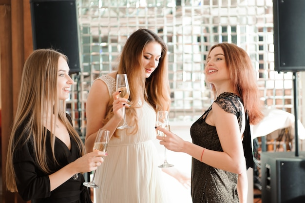 Portrait of smiling friends holding glass of champagne