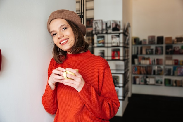 Portrait of a smiling girl dressed in sweater